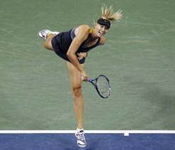 Sharapova shifts up a gear to reach third round