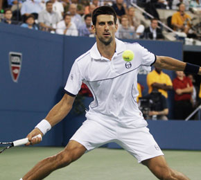 Novak Djokovic of Serbia returns a shot to Rafael Nadal of Spain during the men's championship match at the U.S. Open tennis tournament in New York.