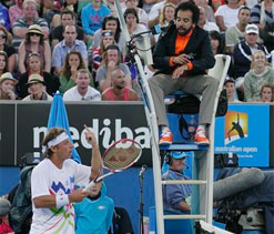 Angry Nalbandian blasts referee after Isner loss