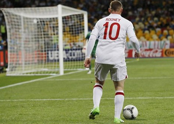 Rooney still needs to improve as a player, says England coach Gary Neville