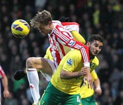 Johnson header moves Norwich above Stoke