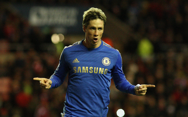 Torres fires twice to give Benitez first league win