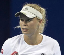 Wozniacki fires coach after losing top spot