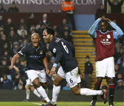Lescott sends Man City back to the top