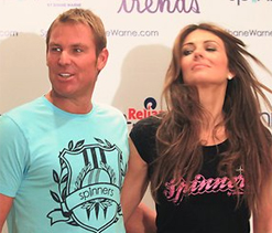 Shane Warne poses with look-alike 'cuddly' lion