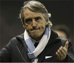 Mancini says Man U's 'five-point' lead too much to beat