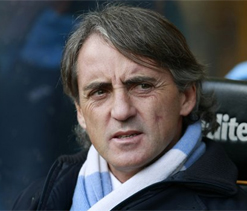 'Satisfied' Man City owner Sheikh Mansour says Mancini's job is safe
