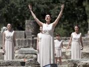 A priestess performs in front of the ancient temple of Hera during the final dress rehearsal for the lighting of the Olympic flame held in Ancient Olympia, Greece.