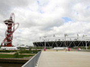 The ArcelorMittal Orbit sculpture, left, before its official unveiling at the Olympic Park, London. The steel sculpture designed by Anish Kapoor and Cecil Balmond stands 114.5 meters (376ft) high, 63% of of the sculpture is recycled steel and incorporates the five Olympic rings.