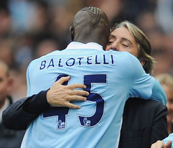 Mancini says Balotelli will definitely stay with Man City next season