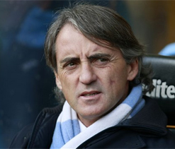 Mancini calls on Man City to become England champs after conquering Manchester