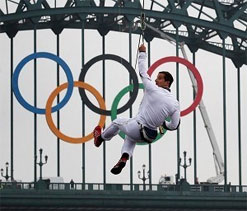 'Dare devil' Grylls flies Olympic flame on zip wire across river Tyne
