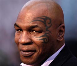 Tyson says Holyfield's ear would have tasted better with his BBQ sauce!
