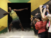 Usain Bolt models a Jamaica Olympic kit designed by Cedella Marley, daughter of Bob Marley, during the kit unveiling in London.