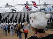 Performers arrive at the Olympic Stadium for opening ceremony rehearsals for the 2012 Summer Olympics in London.