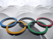 The Olympic rings are displayed outside the basketball arena in the Olympic Park before the start of the 2012 Summer Olympics in London.