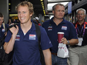 Members of the U.S. Olympic sailing team are escorted following their arrival at Heathrow Airport in London.