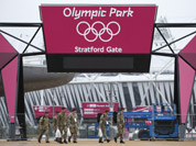 British military personnel enter into the Olympic Park before the start of the 2012 Summer Olympics in London.