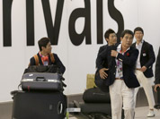 Members of the South Korean Men Gymnastics team arrive at Heathrow Airport in London.