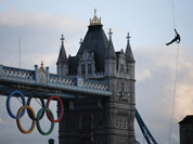 Royal Marine Martyn Williams, rappels down from a Royal Navy Sea King helicopter into the Tower of London with the Olympic torch.