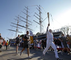 Sun comes out as Olympic torch tours London