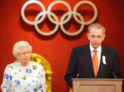 Britain`s Queen Elizabeth II listens as the President of the International Olympic Committee Jacques Rogge speaks at Buckingham Palace, in London.