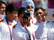 Members of the Indian Olympic team take photos during the Olympic Team Welcome Ceremony at the Athletes` Village at the Olympic Park.