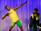 Fans look at the new wax model of Jamaican sprinter Usain Bolt, at a photocall for its launch at the Madame Tussauds wax museum, ahead of the 2012 Summer Olympics.
