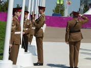 British soldiers raise the Brazilian flag during the Flag Raising ceremony at the Olympic Village in London.