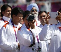 Krishna Poonia, Sudha arrive at Olympic Games Village