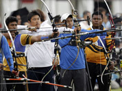Archers from Malaysia, South Korea and Taiwan compete in the individual ranking round at the 2012 Summer Olympics in London.