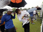 South Korea`s Im Dong-hyun, right, inspects his arrows on the target next to Taiwan`s Kuo Cheng-Wei, in blue, during an individual ranking round at the 2012 Summer Olympics in London.