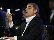 Actor Rowan Atkinson performs during the Opening Ceremony at the 2012 Summer Olympics in London.
