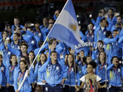 Argentina`s Luciana Aymar carries her national flag during the Opening Ceremony at the 2012 Summer Olympics in London.