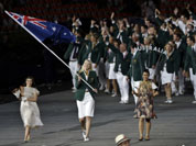 Australia`s Lauren Jackson carries her country`s national flag during the Opening Ceremony at the 2012 Summer Olympics in London.