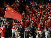 China`s Jianlian Yi carries the flag during the Opening Ceremony at the 2012 Summer Olympics in London.