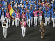 Germany`s Natascha Keller carries the flag during the Opening Ceremony at the 2012 Summer Olympics in London.