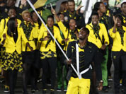 Jamaica`s Usain Bolt carries the flag during the Opening Ceremony at the 2012 Summer Olympics in London.