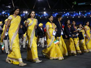 Sania Mirza of India, second from left, parades with fellow athletes during the Opening Ceremony at the 2012 Summer Olympics in London.