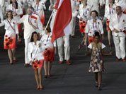 Poland`s Agnieszka Radwanska carries the flag during the Opening Ceremony at the 2012 Summer Olympics in London.