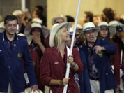 Russia`s Maria Sharapova carries the flag during the Opening Ceremony at the 2012 Summer Olympics in London.