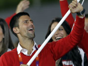 Serbia`s Novak Djokovic carries the flag during the Opening Ceremony at the 2012 Summer Olympics in London.