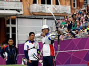 Japan`s Takahuru Furukawa aims for the target during the team elimination stage at the 2012 Summer Olympics in London.