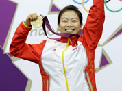 China`s Yi Siling celebrates after winning the gold medal in the women`s 10-meter air rifle event at the 2012 Summer Olympics in London.
