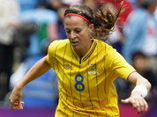 Sweden`s Lotta Schelin, left, battles for the ball against Japan`s Homare Sawa, right, during the group F women`s soccer match between Japan and Sweden at the London 2012 Summer Olympics.