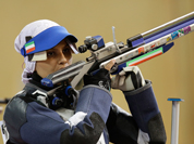 Iran`s Elaheh Ahmadi shoots during the women`s 10-meter air rifle final at the 2012 Summer Olympics.