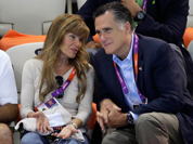 US Republican presidential candidate Mitt Romney, right watches the opening day of swimming competitions at the Aquatics Centre in the Olympic Park during the 2012 Summer Olympics in London.