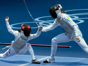 Hyun Hee Nam of South Korea, left, and Olga Leleyko of Ukraine compete in the round of 32 during women`s fencing at the 2012 Summer Olympics.