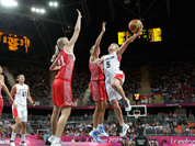 Canada`s Teresa Gabriele (5) shoots over Russia`s Kim Smith (8) and Natalie Achonwa (11) during the second half of a preliminary women`s basketball game at the 2012 Summer Olympics.