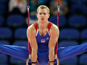 Czech gymnast Martin Konecny performs on the rings during the Artistic Gymnastic men`s qualification at the 2012 Summer Olympics.